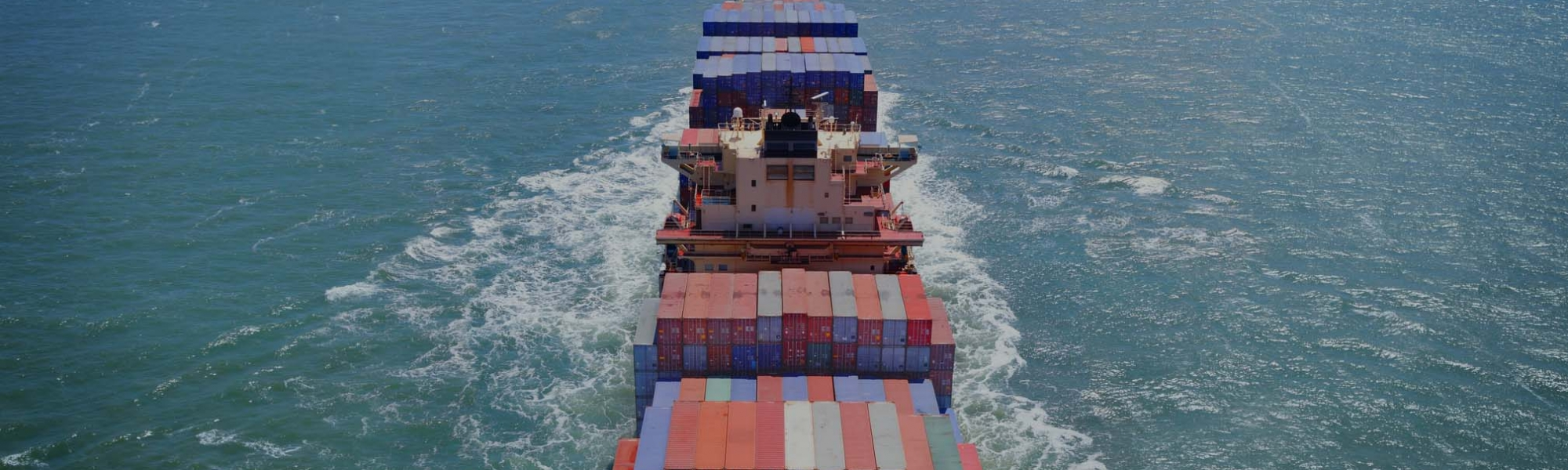 Aerial view of freight ship with cargo containers on the sea. See similar photos: :  http://www.oc-photo.net/FTP/icons/cargo.jpg