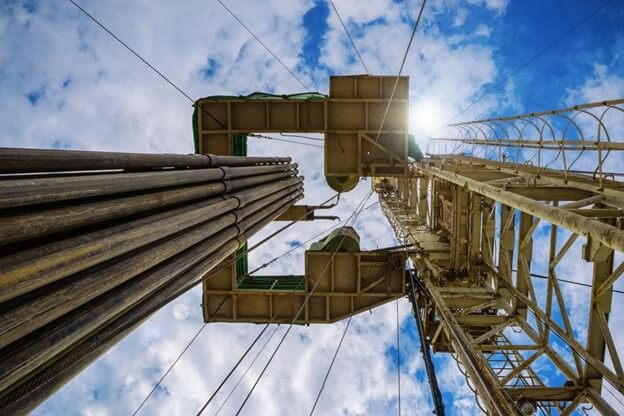 Upward view of oil site utilizing friction reducers for drilling.